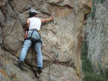 Clipping the second bolt on Qs (5.9+) in The Boulderado area.