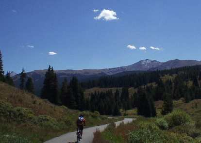 There are dedicated bicycle/runner/blader trails all over summit county threading through the mountains completely away from cars!.