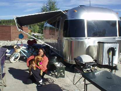 Mike and Kenzie with their Airstreamer at the RV park they are temporarily staying at.
