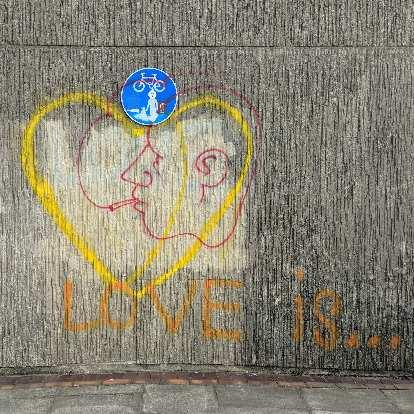 """""""Love is..."""" graffiti near the coast in Brighton and Cove."""