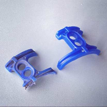 broken blue bottom bracket cable guide with replacement
