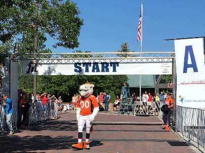 Miles the Mascot at the start line of the Broncos 7k run.