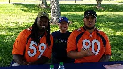 Raquel with Denver Broncos linebacker Vontarrius Dora and nose tackle Kyle Peko.