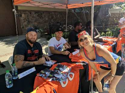 Broncos Dalton Risner and River Cracraft with Emily.