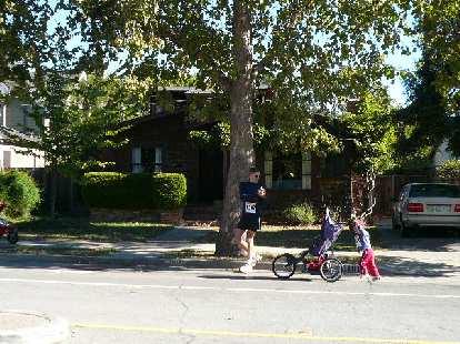 Baby pushing his stroller.