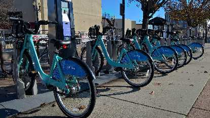 turquoise Bay Area Bike Share bicycles in Redwood City