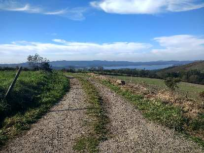 A few miles east of Oveira on the Camino de Fisterra, I could see the waters of Encoro de Fervenza.