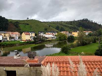 Homes and a river in Bustio, Spain.