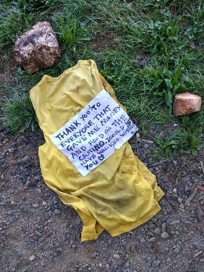 """A sign that read, """"Thank you to everyone that gave me money and food on the Camino. I could not have walked without you."""""""