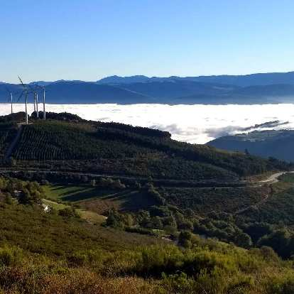 Windmills and fog in Bustelo del Camín, Spain.