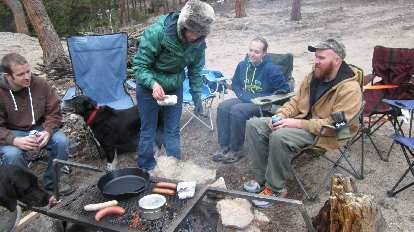 Cooking dinner on the campfire.