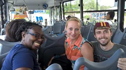Pauline Asher, Jana Anderson, Alberto François on bus in Cancun