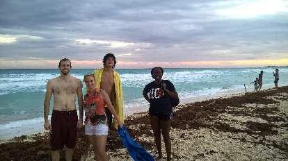 Alberto François, Jana Nicholson, Renzo Ibañez, Pauline Asher standing on beach in Cancún