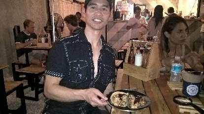 Felix Wong, black shirt, two tacos, Carla