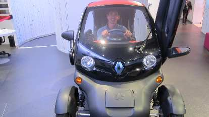 Felix Wong behind the wheel of a Renault Twizy.