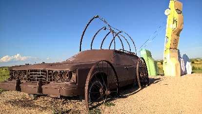 Brown 70s station wagon at Carhenge.