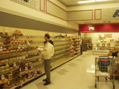 Being inside Albertson's was surreal, since during the blizzard it was not able to be restocked.  The bread shelves were near-empty, and there were rows of empty fruit stands (not shown).