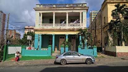 A newish Mercedes C-Class sedan in Havana, Cuba.