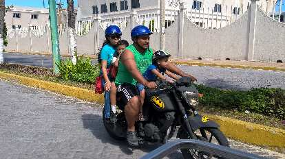 four Mexicans including two kids on a Batman motorcycle, Isla Mujeres