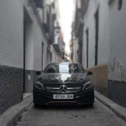 A black Mercedes sedan in the streets of