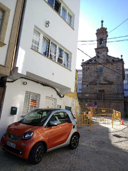 An orange 2016 Smart Fortwo coupe in Fisterra, Spain.