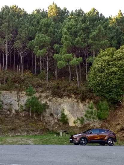A maroon Toyota CH-R hybrid in Fisterra, Spain.