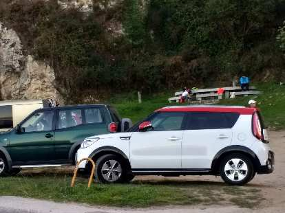 A white second-generation Kia Soul wiht a red roof in Fisterra, Spain.