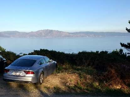 A silver Audi A7 along the eastern shore of Fisterra, Spain.