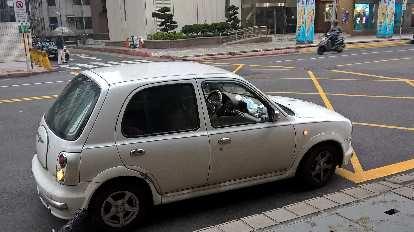 white Nissan March Bolero