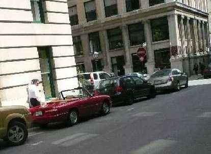Also in Old Montreal, I saw my Alfa Romeo there, but in red.  I would have taken a better photo except then the two guys shown in the photo went up to admire it.