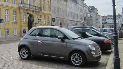 Fiat 500 (and a Porsche Boxster behind it) in Copenhagen.