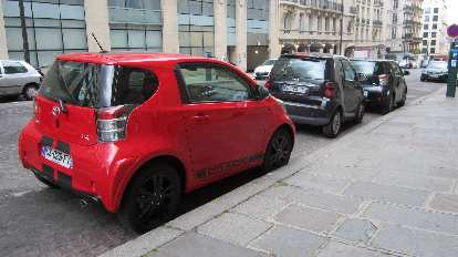 A Scion IQ behind two Smart cars in Paris.