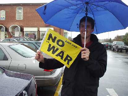 """The Research Triangle is very liberal, although admittedly I might have gotten that impression by hanging around with Dan a lot.  Here he is with a """"No War"""" flag."""