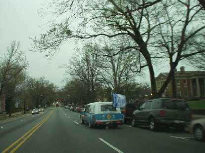 I happened to be downtown when UNC just beat Michigan State to make it into the Final Four in the NCAA mens basketball tournament, and hence this hearse in the UNC colors was cruising through.  UNC would later win the championship.