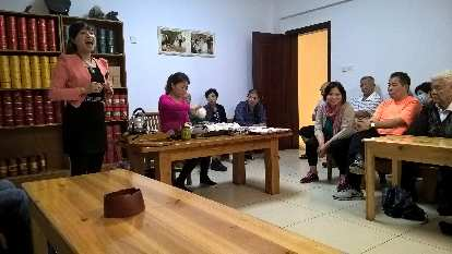 A Chinese tea house representative making a presentation about the efficacy of her teas.