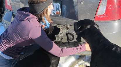 Diana writing a note for Jordan on the bumper with Danny and Oso trying to help.