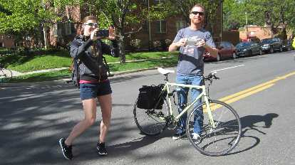 Ellen Silva, Terry Grenwelge taking photos at the 2015 Colfax Half Marathon