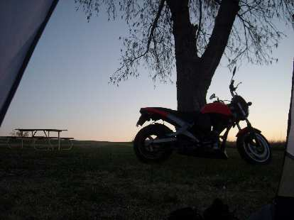 Waking up in the morning to the sight of a nice sunrise and the Buell.