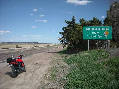 "After a few hours of riding through eastern Colorado, I made it to Nebraska.  Seems like part of ""the good life"" is shooting at this sign."