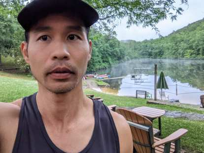 Felix Wong in front of Loch Haven Lake before the Conquer the Cove Trail Marathon.
