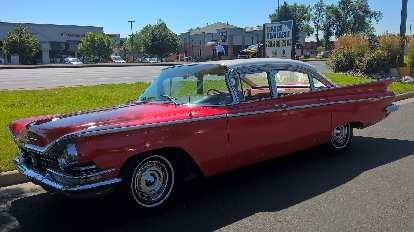 A red 1960s Cadillac sedan.