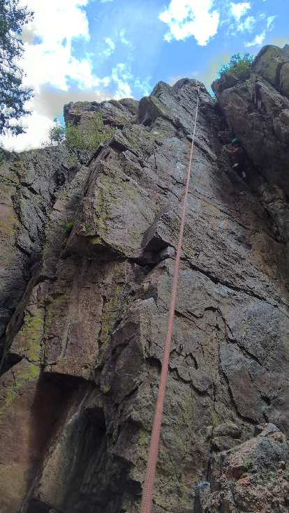 Diana climbing County Line (5.8) in the Southwest Alcove of Crystal Wall.