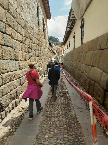 Walking down an alley featuring Inca stonework.