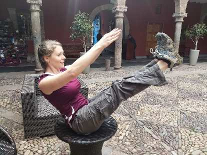 Teresa doing a yoga pose on a table in the terrace of the Hotel Costa del Sol Ramada.