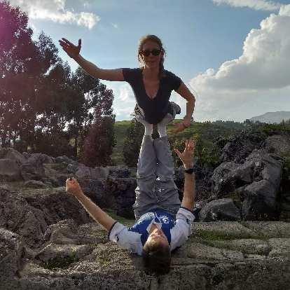 Teresa and Matthew doing an acroyoga pose.