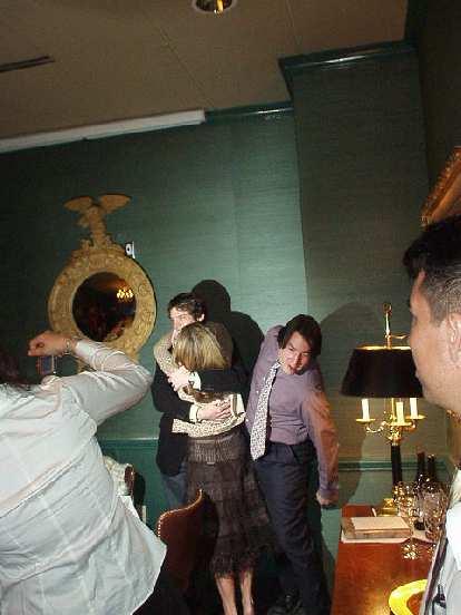 Dan hugging Susan, with brother David behind.
