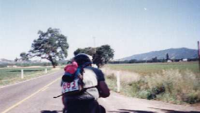 Following a cyclist within a paceline on flatlands near the end of the 1999 Davis Double Century.