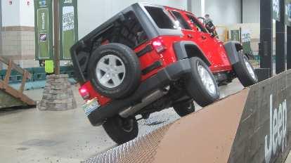 red 2015 Jeep Wrangler, sideways incline, 2015 Denver Auto Show