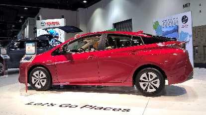 Red 2016 Toyota Prius.