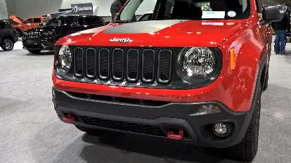 The cheerful face of a red 2016 Jeep Renegade.
